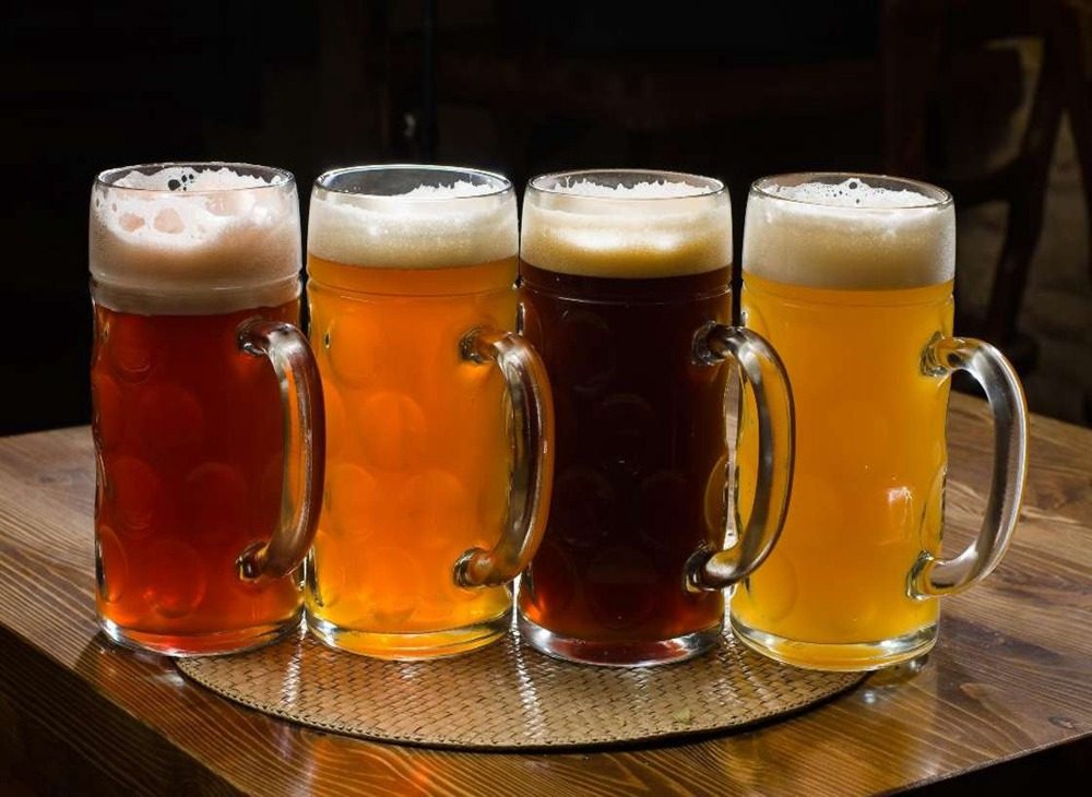What are the effects of various ions in water on beer b